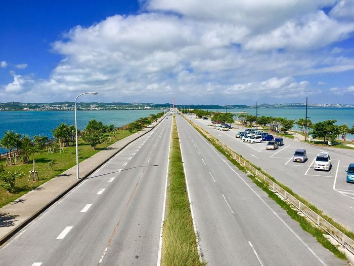 Japan Okinawa Transportation Road Cloud - Sky Sky Mode Of Transportation Direction The Way Forward Diminishing Perspective Car Land Vehicle Motor Vehicle Nature Day Highway vanishing point No People Tree Street Sign Marking Outdoors Multiple Lane Highway Dividing Line