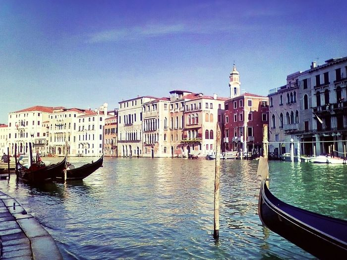 Cultures Gondola - Traditional Boat Canal Travel Destinations Transportation Mode Of Transport Travel Building Exterior Nautical Vessel Architecture Gondolier Tourism Wooden Post Built Structure Water Outdoors Day Vacations Sky No People Venice Italy Veneto Canal Grande Venezia
