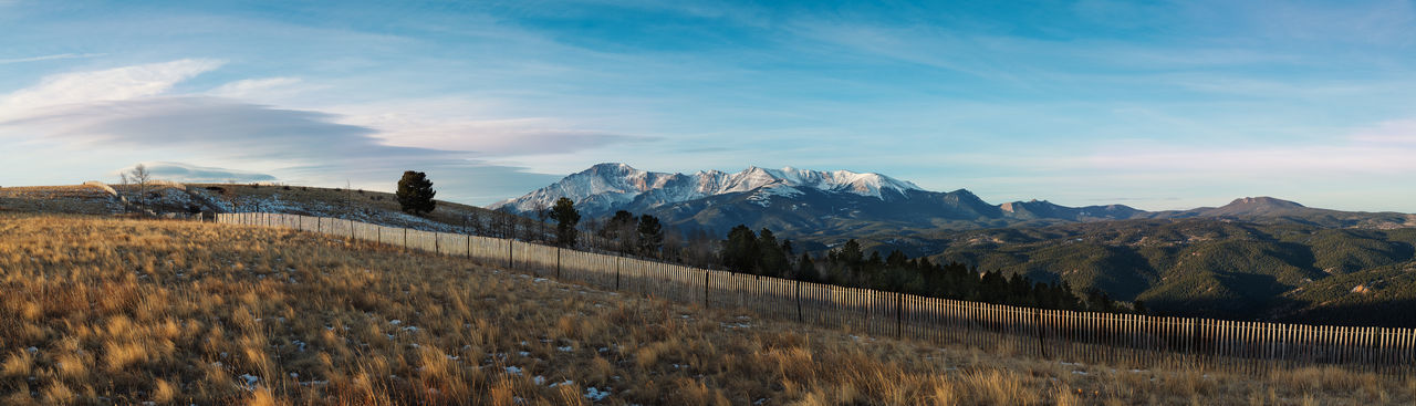 Mountain Views Backgrounds Beauty In Nature Cloud - Sky Day Environment Fence Fences Grass Land Landscape Mountain Mountain Peak Mountain Range Nature No People Non-urban Scene Outdoors Panoramic Rolling Landscape Scenics - Nature Sky Snowcapped Mountain Tranquil Scene Tranquility Tree EyeEmNewHere