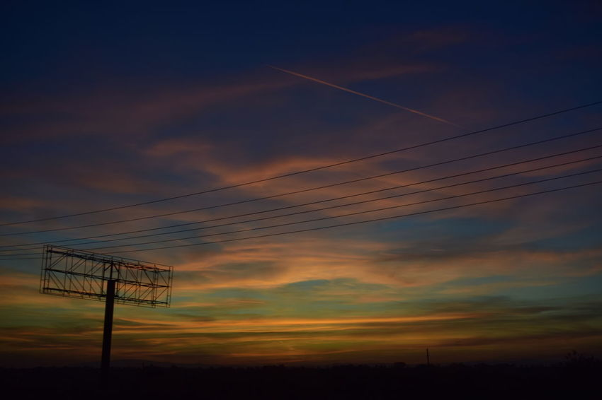 Beauty In Nature Cable Cloud - Sky Connection Electricity  Electricity Pylon Fuel And Power Generation Landscape Low Angle View Nature No People Outdoors Scenics Silhouette Sky Sunset Technology Tranquility Colour Your Horizn