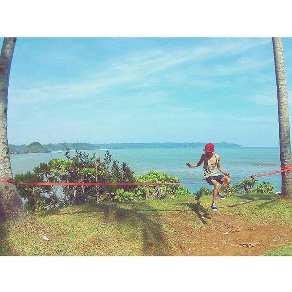 Karapyak beach, Ciamis, West Java, Indonesia. Vacations Nature Beauty In Nature Cloud - Sky Exploreindonesia Naturephotography Travel Photography Vibes Wanderlust Wanderlust Nature Wanderlustindonesia Beach Slackline Sea