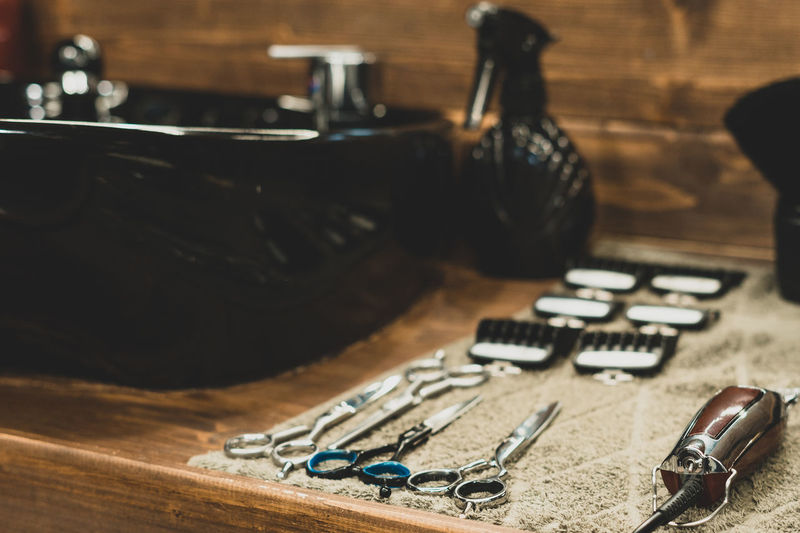 Close-up of work tool on table at salon