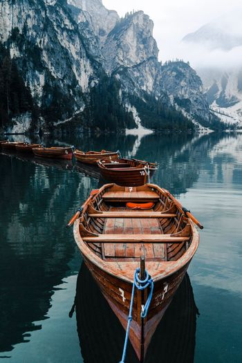 Boat Moored On Lake Against Mountains