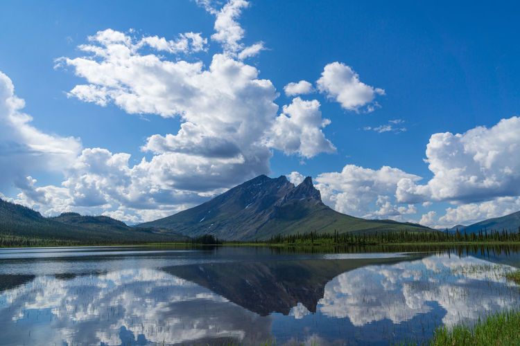Scenic view of lake and mountains against sky