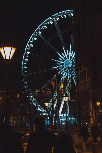 Camera - Canon 550D -Lens - 50 mm f/1.8 Blog : https://www.instagram.com/david_sarkisov_photography/ Amusement Park Amusement Park Ride Night Illuminated Ferris Wheel Arts Culture And Entertainment Architecture Built Structure Leisure Activity City Incidental People Carnival Enjoyment Spinning Outdoors Building Exterior Dark Low Angle View Traveling Carnival Group Of People Nightlife Christmas Market Streetwise Photography