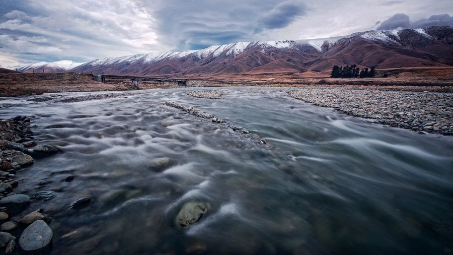Beauty In Nature Central Otago Cloud - Sky Day Hawkduns Landscape Long Exposure Manuherikia River Mountain Nature New Zealand No People NZ Outdoors Sky Snow Water