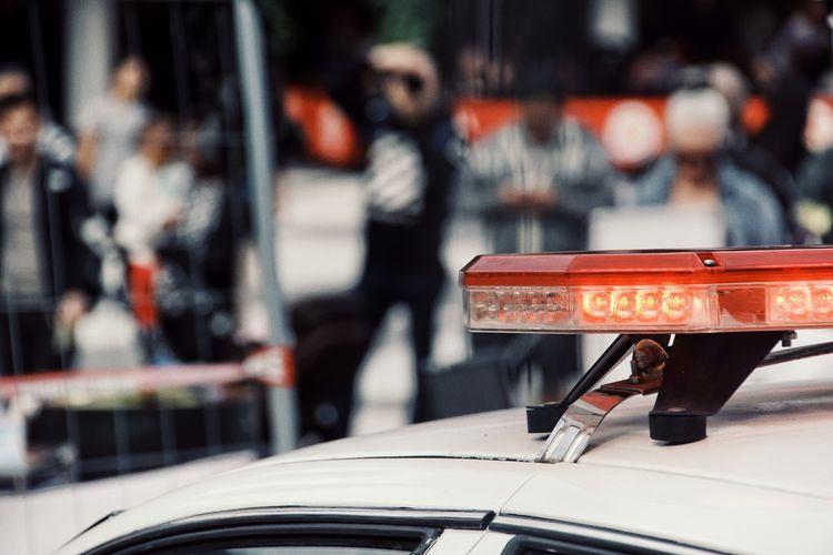 Close-Up Of Car Against Defocused People