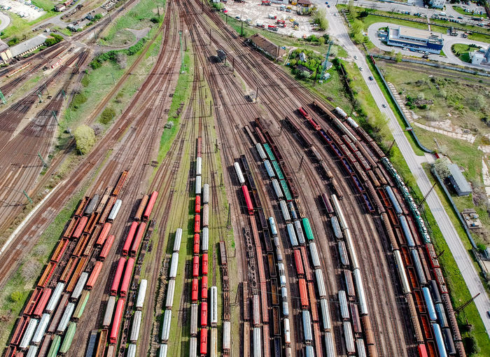 Aerial View Architecture Business Cargo Container Container Day Environment Freight Transportation High Angle View Industry Land Land Vehicle Mode Of Transportation Multi Colored Multiple Lane Highway Nature No People Outdoors Plant Road Transportation Trucking