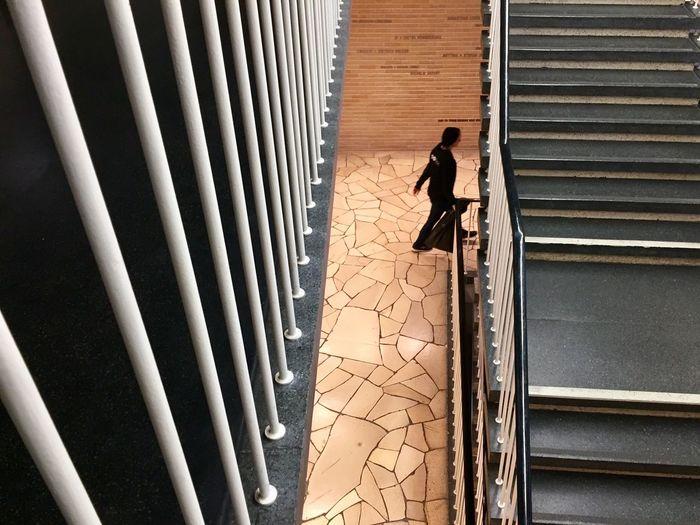 Shadow of man on bridge
