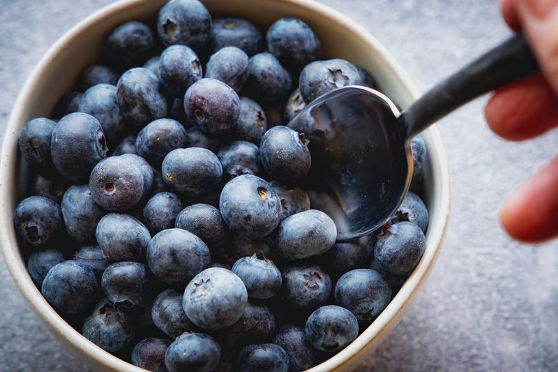 Blueberries Food Food And Drink Human Hand Healthy Eating Hand Fruit Human Body Part Wellbeing Berry Fruit Bowl Freshness Blueberry Kitchen Utensil Close-up Finger Real People One Person Human Finger Holding Body Part