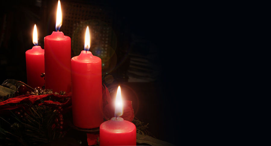 Christmas time, four candles lit on black background Black Background Burning Candle Candlelight Celebration Christmas Darkroom Decoration Fire - Natural Phenomenon Flame Glowing Heat - Temperature Illuminated Indoors  Lighting Equipment No People Red Symbol Wax