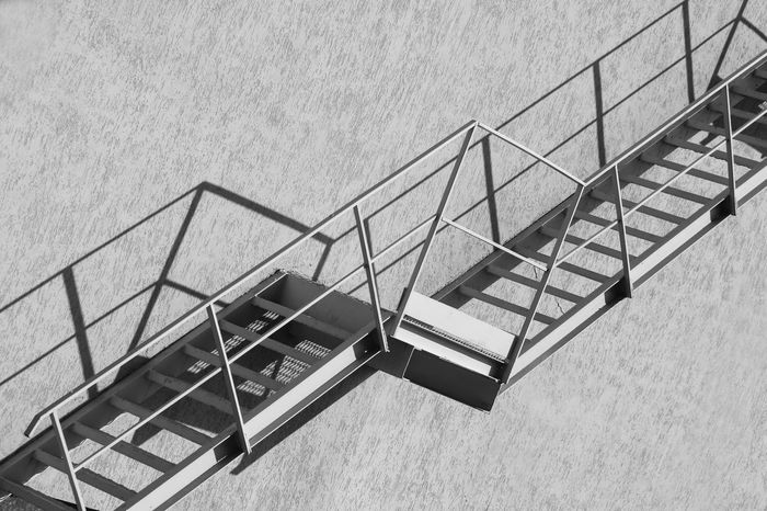 Architecture Black & White Black And White Building Exterior Built Structure Fire Escape Geometry Geometry Everywhere Light And Shadow Low Angle View No People Outdoors Railing Staircase Stairs Steps Steps And Staircases