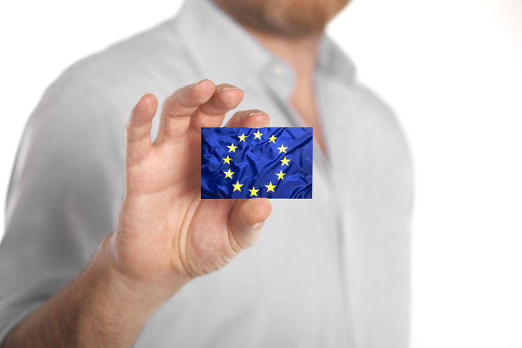 Holding One Person Studio Shot White Background Human Hand Human Body Part Hand Indoors  Close-up Front View Men Blue Adult Midsection Focus On Foreground Cut Out Human Finger Body Part Finger Human Limb European  European Union Eu