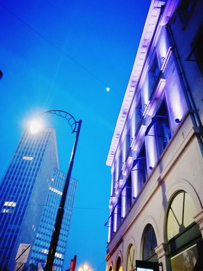 Purple Purple Color Violet Bleu Huawei P9 Leica Huaweiphotography Streetphotography Bruxelles-Capital Architecture Night Illuminated Low Angle View No People Built Structure Outdoors Sky Blue City Clear Sky Colour Your Horizn