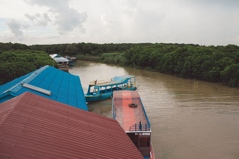 High Angle View Of Boats Moored On River Against Sky