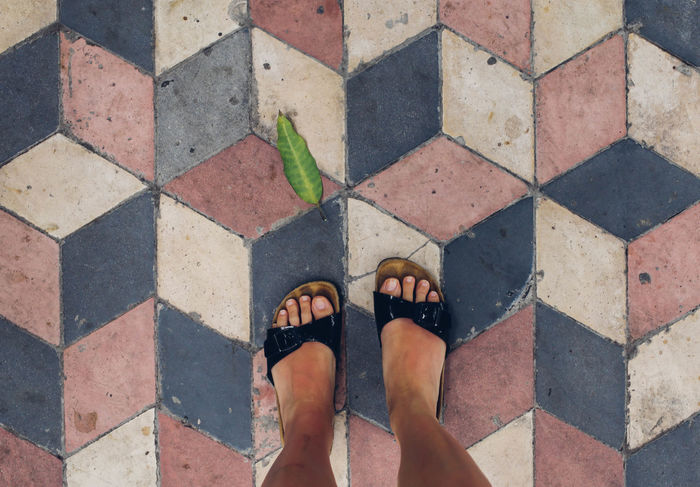 ASIA Banda Island Cobblestone Floor Fromwhereistand High Angle View Human Foot INDONESIA Lifestyles Maluku  Pattern Person Personal Perspective Shoe Standing Street Travel Unrecognizable Person