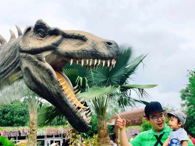Father and son Kids ASIA Dinosaur Travel Happiness Still Life Future Studying Playing Love Baby Growth Children Smiling Park Holiday Vacations Childhood Real People Sky Representation Cloud - Sky Boys Looking Child People Nature Lifestyles Males  Men