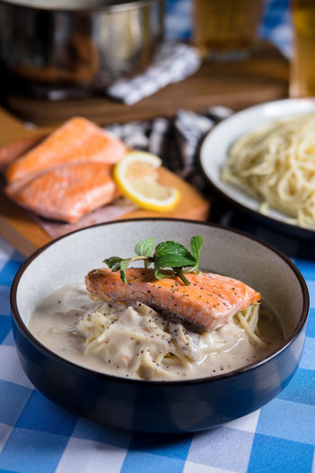 Salmon Carbonara Bowl Carbonara Citrus Fruit Close-up Focus On Foreground Food Food And Drink Freshness Fruit Garnish Healthy Eating Indoors  Japanese Food Meal Meat Plate Ready-to-eat Salmon Seafood Serving Size Still Life Table Temptation Wellbeing