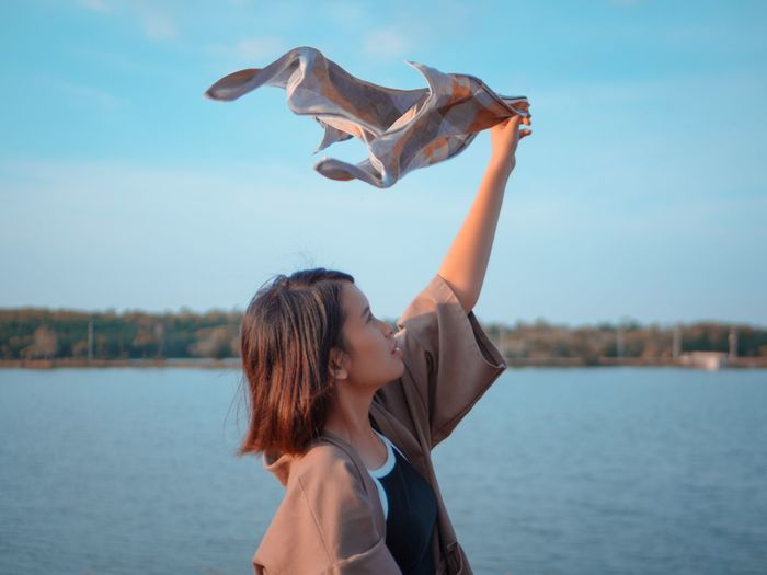 freedom! freedom! Water Sky Nature Women One Person Portrait Focus On Foreground Happiness Outdoors Freshness Air Flow  Towel EyeEmNewHere EyeEm Best Shots EyeEm Nature Lover EyeEm Selects Getty Images Day Feel The Journey KimonoStyle Adult Arm Beauty In Nature