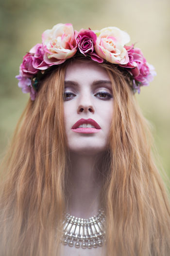 Beauty Casual Clothing Close-up Day Flower Focus On Foreground Fragility Headshot Leisure Activity Lifestyles Long Hair Outdoors Pink Color Portrait Red Hair ❤ Toothy Smile Young Women