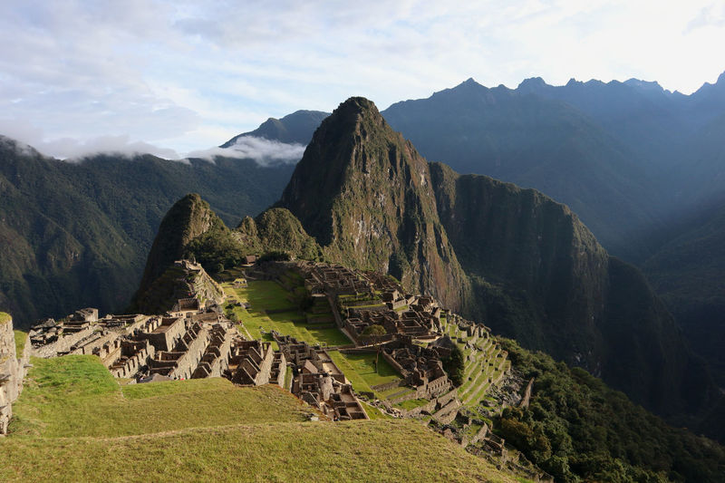 Scenic view of mountains against cloudy sky - machu picchu