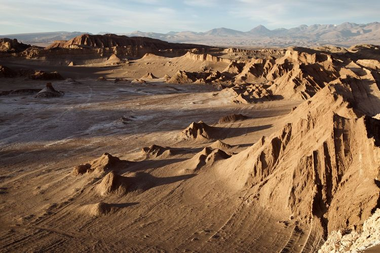 Scenic view of rock formations at desert against sky