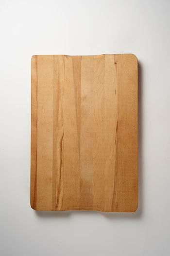 High angle view of cutting board on table against white background