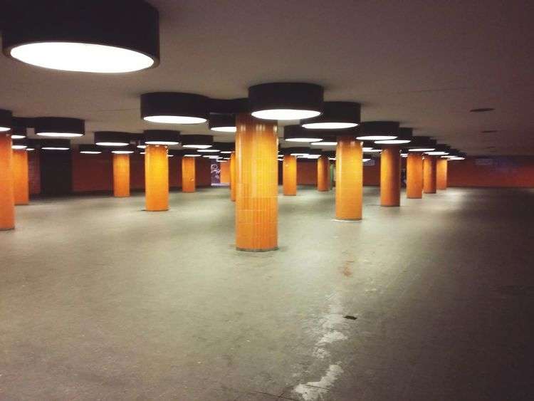 Berlin Underground. · Germany 030 Subway Station Train Station Metro Station Architecture Columns Pillars Colors Orange Lighting Light And Shadow Infinity