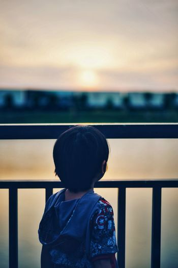 EyeEmNewHere Eyeemkids EyeEm Eyeemphotography Kidsphotography EyeEm Best Shots Child Childhood Standing Sunset Boys Sky Thoughtful Children Asian  Silhouette Thinking Friend Wearing Head And Shoulders A New Beginning A New Perspective On Life It's About The Journey Capture Tomorrow 2018 In One Photograph The Portraitist - 2019 EyeEm Awards