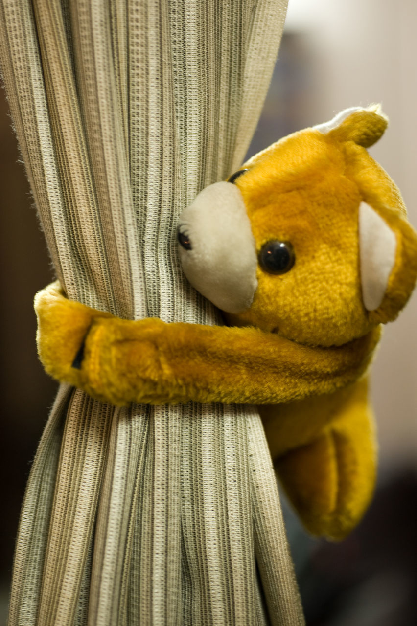 stuffed toy, animal representation, yellow, toy, close-up, no people, hanging, indoors, teddy bear, childhood, day, animal themes