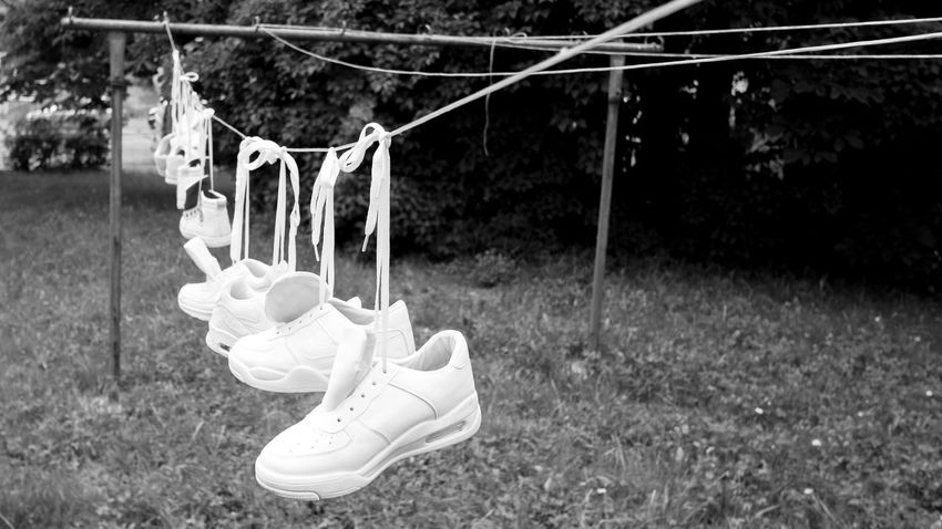 Blackandwhite Close-up Day EyeEmNewHere. Field Full Length Grass Hanging Laundry Laundryday No People Out Of The Box Outdoors Shoes Sport