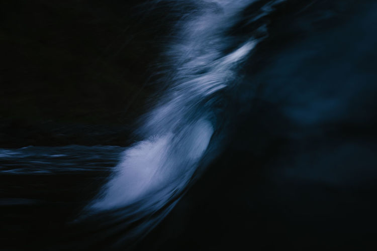 Darkness wave breaking with slow exposure