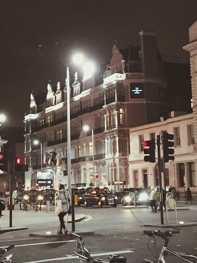 EyeEm LOST IN London Ampersand Night Illuminated Architecture Built Structure Building Exterior City Street Street Light Land Vehicle Transportation Road Outdoors Real People Sky Adult People