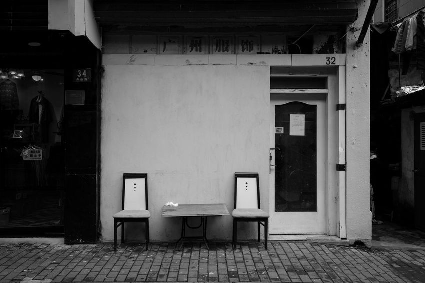 Architecture Built Structure Building Exterior Building No People Seat Empty Entrance Door Absence Day Chair Outdoors City Street Footpath House Open Table Garbage Bin Blackandwhite Streetphotography