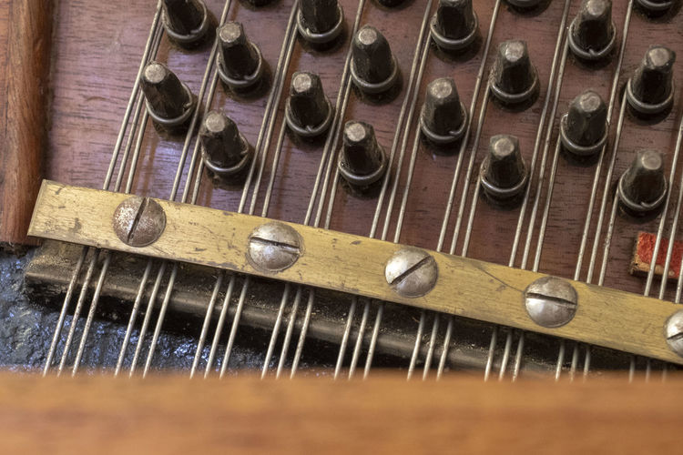 Antique Arts Culture And Entertainment Close-up High Angle View Indoors  Metal Music Musical Equipment Musical Instrument Musical Instrument String No People Old Selective Focus Silver Colored Still Life String String Instrument Studio Shot Wood - Material