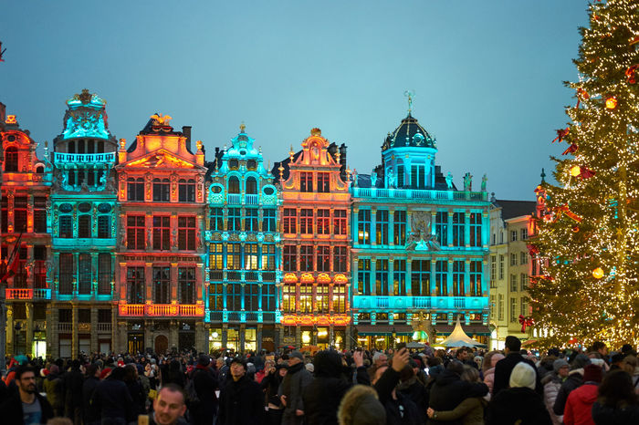 Grand Place -Bruxelles during Christmas - Architecture Bruxelles Building Exterior Christmas City City Life Cityscape Clear Sky Crowd Dusk Europe Flag Government Grand Place Illuminated Large Group Of People Night Outdoors People Seasons Greetings Sky Travel Travel Destinations Tree