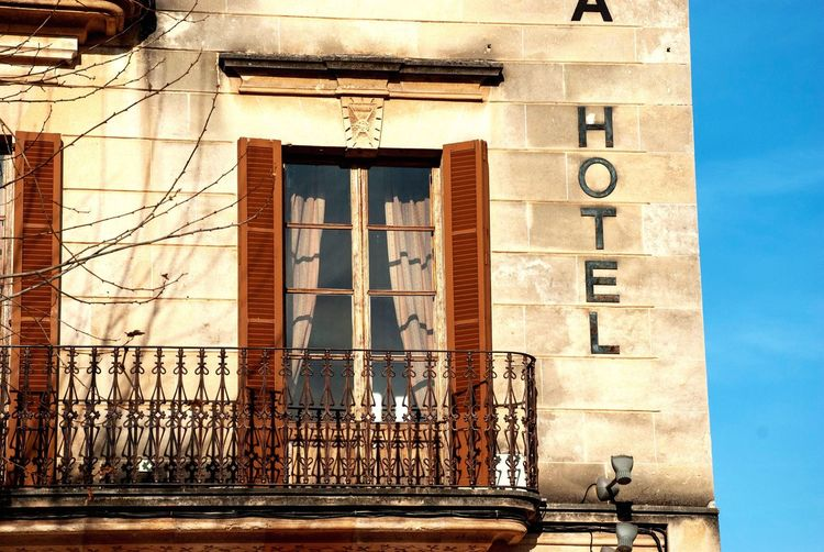 Old Hotel on Mallorca SPAIN Mallorca Balearic Islands House Hotel Spanish Pollença Built Structure Architecture Building Exterior Day No People Communication Wall - Building Feature Sunlight Building Wall Text Old Outdoors Window Western Script