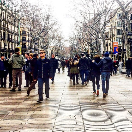 City Bare Tree Winter Large Group Of People Walking City Life People Tree Built Structure Women Day Adult Warm Clothing Outdoors Real People Men Cold Temperature Adults Only Crowd Ice Rink Barcelona Ramblas Canaletes Font De Canaletes Rambla