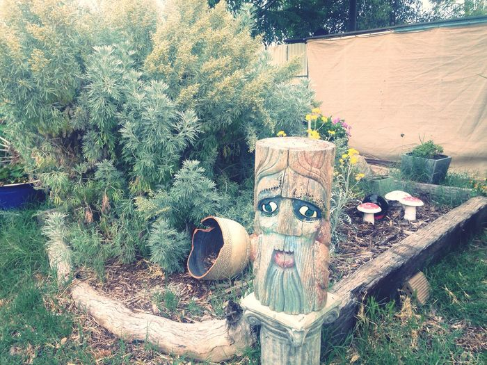 Wood carving in garden