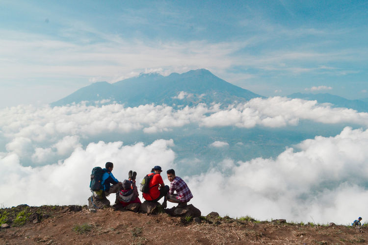 Mountain Sky Beauty In Nature Real People Group Of People Scenics - Nature Leisure Activity Men Cloud - Sky Nature Environment Adventure Hiking Mountain Range Day Activity Togetherness Landscape Non-urban Scene Lifestyles Outdoors