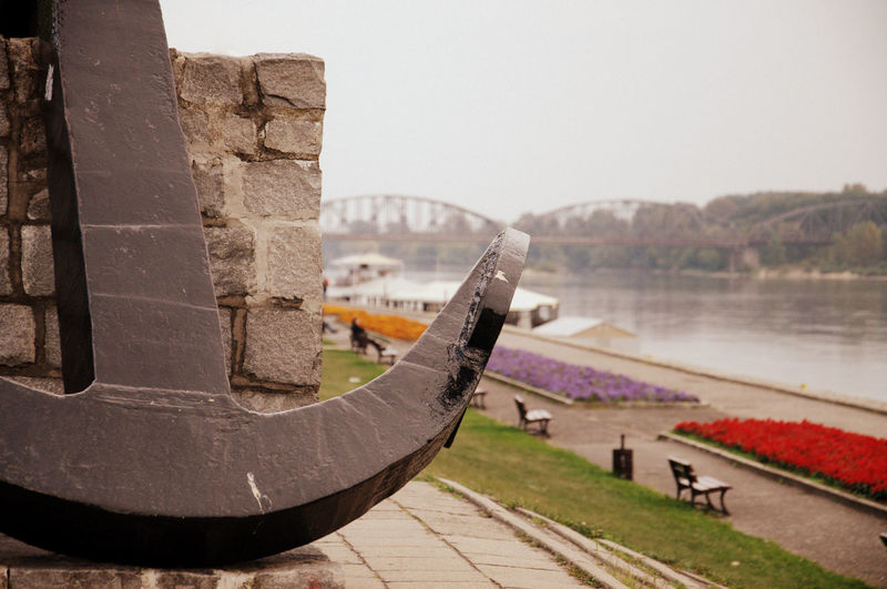Cropped image of anchor against river