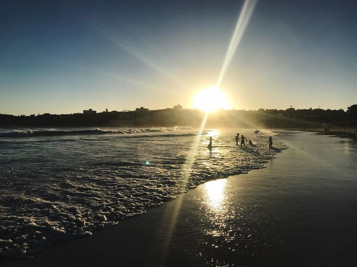 Ocean love Swimming Bondi Beach Freedom Healthy Lifestyle Health Evening Sand Shore Waves Ocean Summer Happiness Joy Silhouettes Sky Water Sunlight Scenics - Nature Lens Flare Sun Beauty In Nature Tranquility Sunset Sunbeam Outdoors Sea Beach Nature Reflection Tranquil Scene