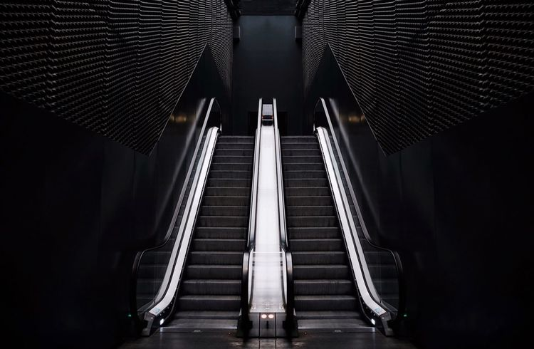 - UP, PLEASE - Check This Out Symmetrical Symetry Artsy Building Garage Black Escalators Escalator Built Structure Architecture Indoors  Low Angle View No People Modern Illuminated Day