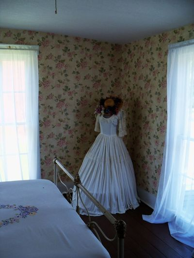 Scotland Hotel Museum in Scotland, Indiana 1800s Absence Bed Casual Clothing Comfortable Corridor Curtains Day Domestic Room Dress Empty Hat Historic Clothing Historic Dress Home Indiana Lifestyles Metal Bed Frame Museum Relaxation Scotland Hotel Museum Scotland, Indiana Small Town USA Wallpaper Windows