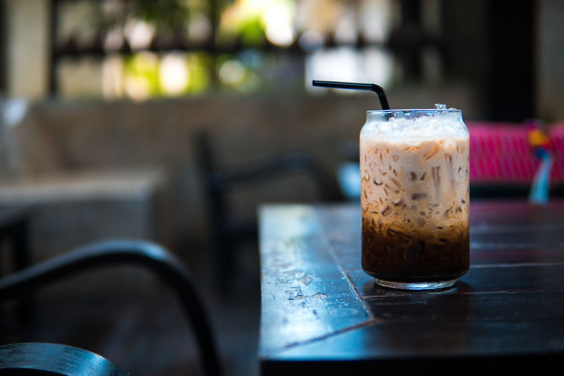 latte coffee in summer day Cafe Close-up Coffee Coffee - Drink Day Drink Drinking Glass Drinking Straw Focus On Foreground Food Food And Drink Freshness Glass Household Equipment Indoors  No People Refreshment Still Life Straw Table Temptation
