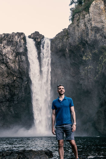 Tall handsome man wearing blue shirt standing next to a powerful waterfall Adventure Travel Beauty In Nature Blue Shirt Casual Clothing Flowing Water Front View Handsome Leisure Activity Long Exposure Male Model Motion Nature One Person Outdoor Recreation Outdoors Polo Shirt  Real People Rock Rock - Object Scenics - Nature Standing Three Quarter Length Water Waterfall Young Adult My Best Travel Photo