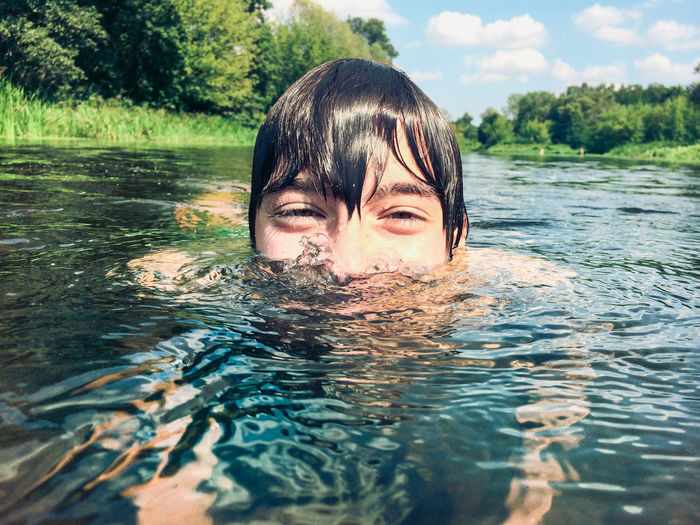 Surface Level View Of Boy In River