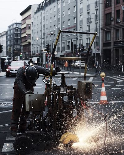 Manual worker on street in berlin