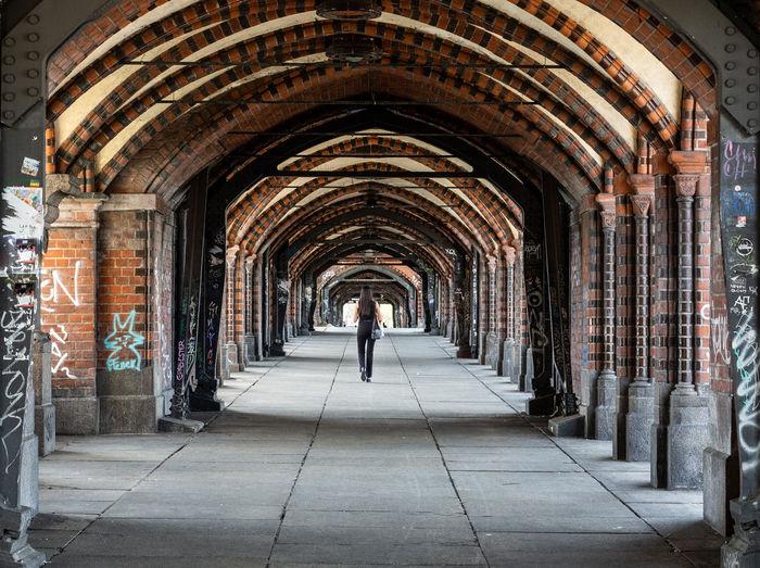 Rear view of man standing in corridor of building