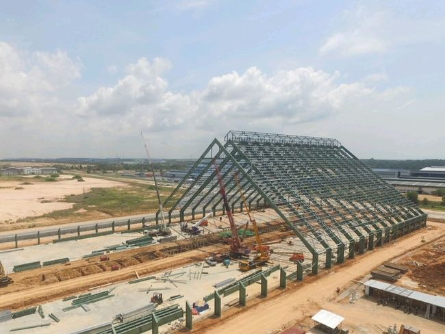 Industry High Angle View Built Structure Outdoors Sky Metal Industry Silo Superstructure Day Lifting Cranes Metalwork Structural Steel Triangle Architecture Industry Heavy Lifting Cranes And Construction